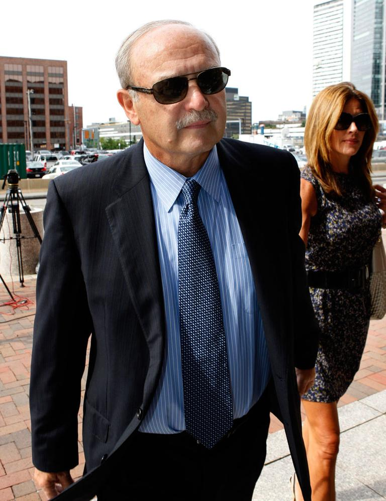 Former Speaker Salvatore DiMasi, accompanied by his wife Debbie, arrives for his sentencing hearing Friday in Boston federal court. (AP)