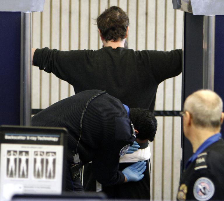 A passenger receives a pat down at a security checkpoint at Logan International Airport in Boston. (AP)