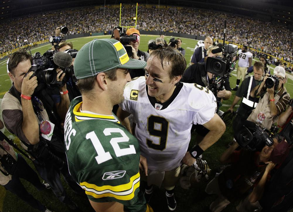Green Bay Packers quarterback Aaron Rodgers talks to New Orleans Saints quarterback Drew Brees after the Packers won the NFL season opener, 42-34.  (AP)