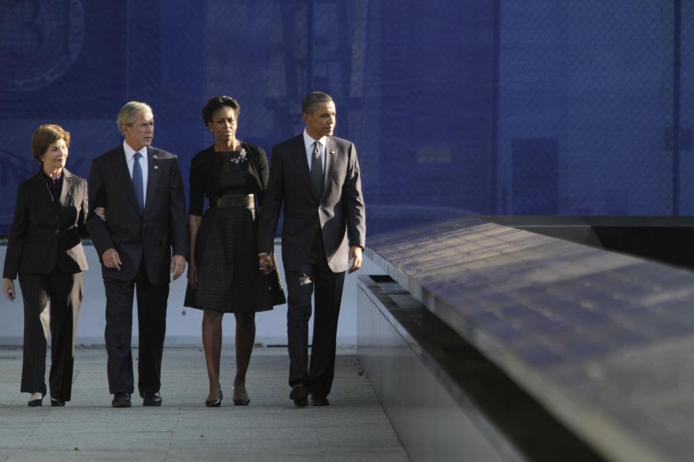 President Obama, right, first lady Michelle Obama, former President George W. Bush and former first lady Laura Bush arrive at the National September 11 Memorial in New York Sunday. (AP)