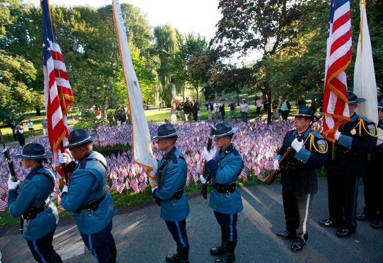 A police color guard stands in front of 3,000 American flags, symbolizing the victims of the 9/11 terror attacks, during ceremonies in the Boston Public Garden Sunday. (AP)
