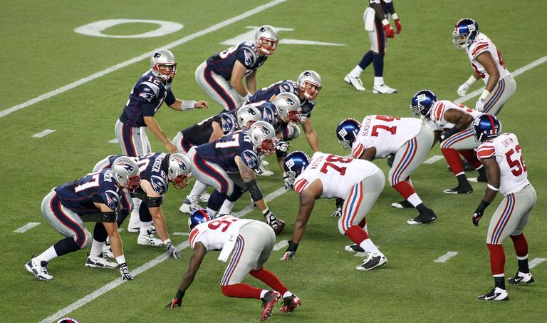 New England Patriots quarterback Tom Brady directs the offense in a preseason game against the New York Giants Sept 1. (AP)