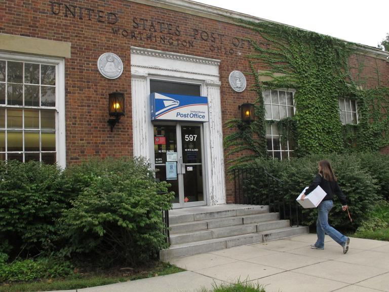 In this photo taken Wednesday Sept. 7, 2011, Allison Fisher, 25, visits a post office to mail textbooks in Worthington, Ohio. (AP)