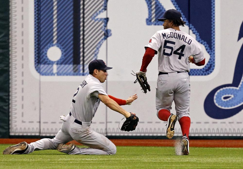 Jacoby Ellsbury and Darnell McDonald of the Red Sox can't catch up to Desmond Jennings' eleventh inning triple in Saturday's game against the Rays. The Sox lost 6-5. (AP)
