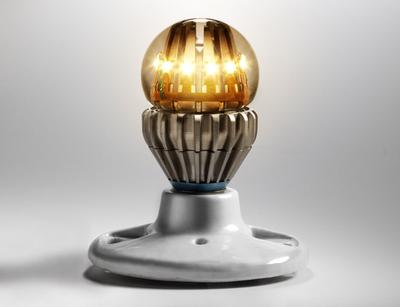 This illuminated LED light bulb, made by Switch, has a liquid filled dome that prevents the LED from overheating.  (Misha Gravenor/Wired)