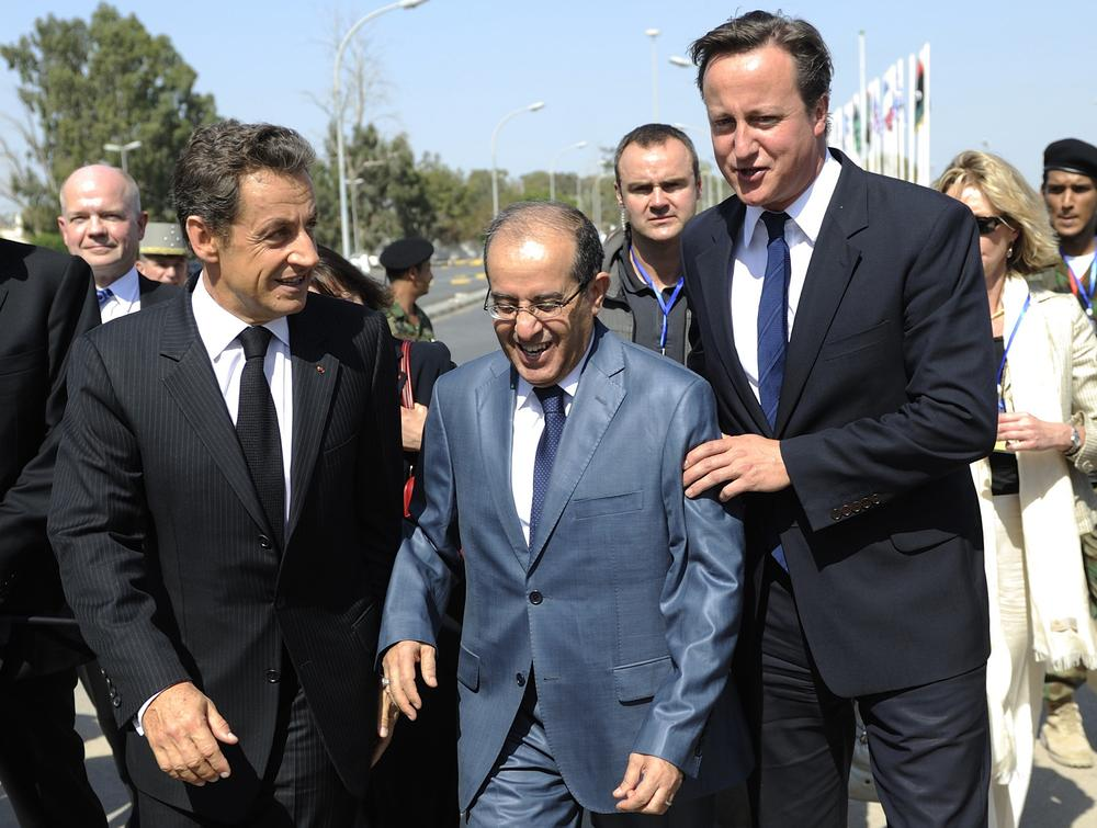 French President Nicolas Sarkozy, left, NTC prime minister Mahmoud Jibril, center, and British Prime Minister David Cameron, right, walk ahead of a visit to the Tripoli Medical Center in Tripoli, Thursday. (AP)