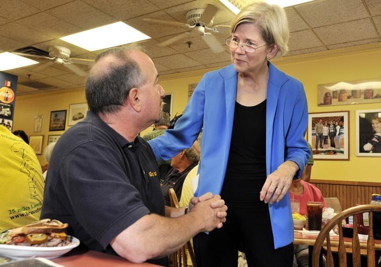 Democrat Elizabeth Warren, right, a Harvard Law professor and consumer advocate, speaks with voters in Framingham, Wednesday. (AP)