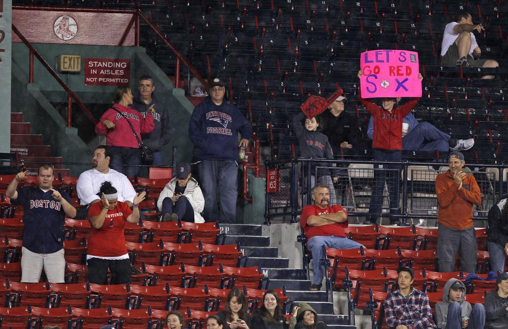Red Sox fans cheer from nearly empty stands at Fenway Park on Thursday. The cheers turned to tears as the Rays beat Boston 9-2. (AP)