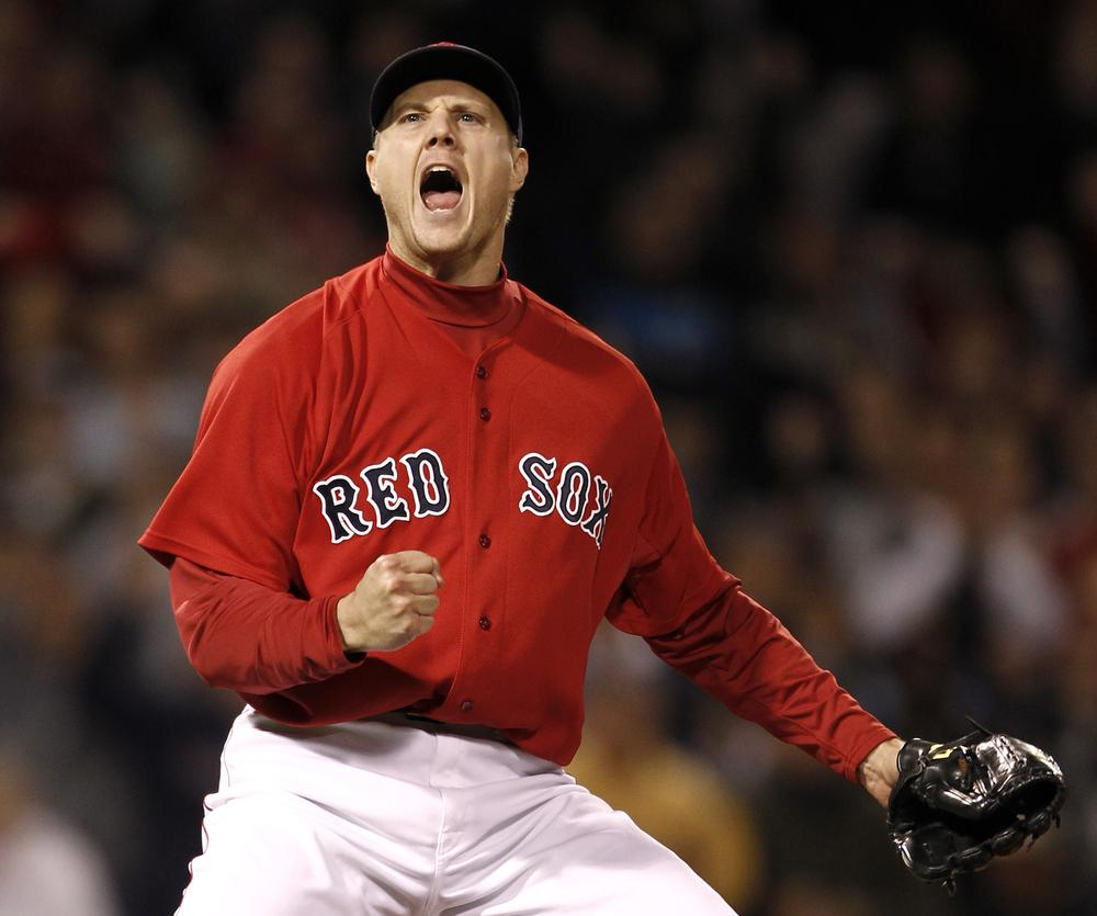 Jonathan Papelbon pumps his fist after striking out Tampa Bay Rays' Evan Longoria to end the game during Boston's 4-3 win. (AP)