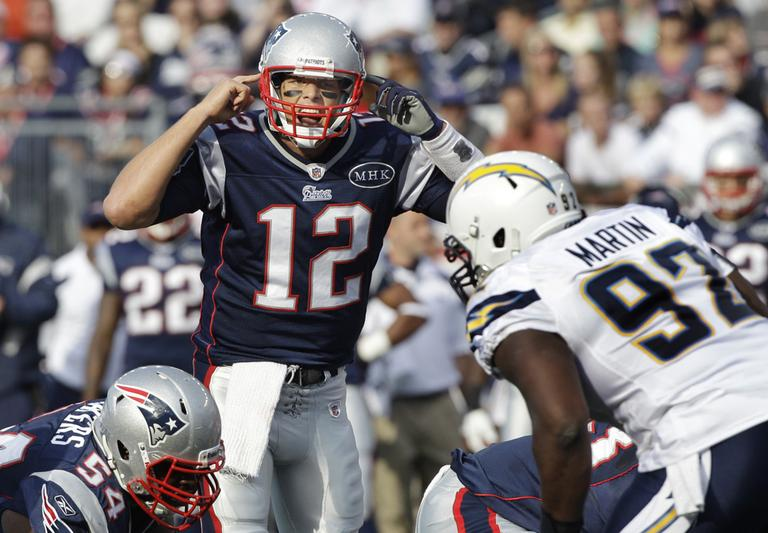 New England Patriots quarterback Tom Brady (12) yells at the line of scrimmage as San Diego Chargers defensive tackle Vaughn Martin (92) prepares for the hike during the first half of an NFL game Sunday. (AP)