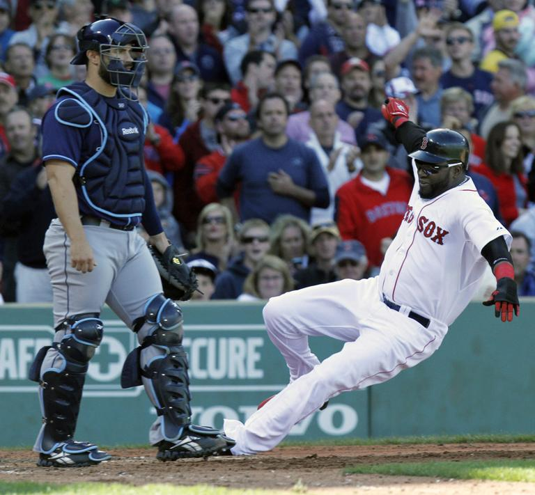 Boston Red Sox's David Ortiz, right, scores in front of Tampa Bay Rays' Kelly Shoppach on an RBI-double by the Red Sox's Darnell McDonald in the fourth inning of a baseball game on Sunday. (AP)