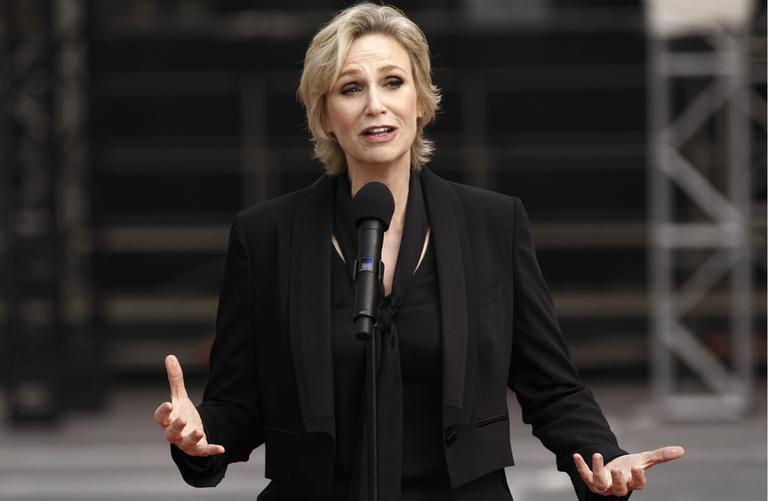 Actress Jane Lynch speaks before the rollout of the red carpet for the 63rd Primetime Emmy Awards in Los Angeles, Wednesday, Sept. 14, 2011.  (AP)