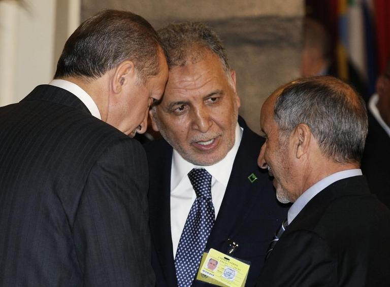 Turkish Prime Minister Recep Tayyip Erdogan, left, speaks with two members of Libya's Natioal Transitional Coucil, Mukhtar Abdurrazaq, center, and Chairman Mustafa Abdel Jalil, at a UN luncheon.