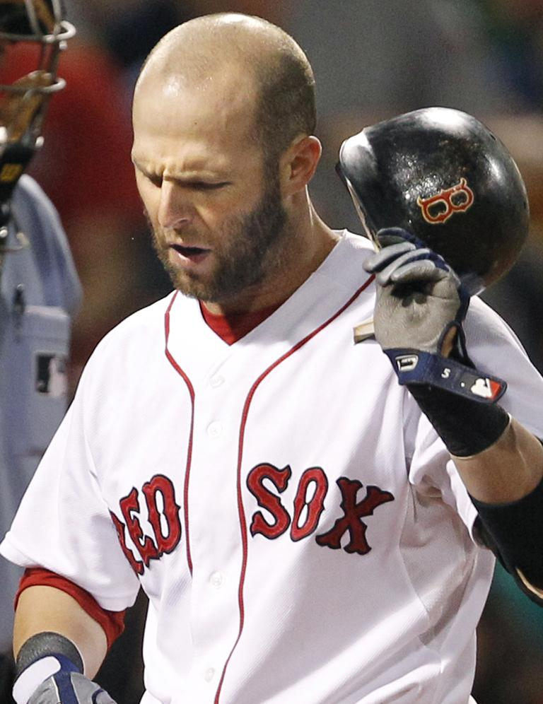Sox second baseman Dustin Pedroia reacts to striking out Wednesday. (AP)