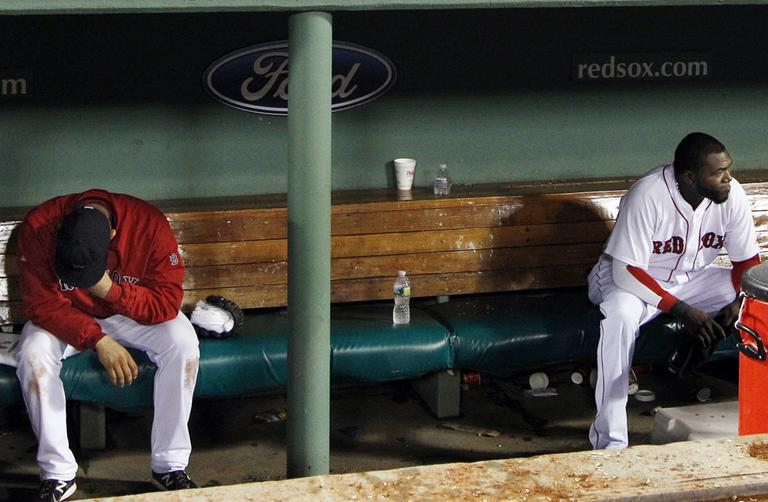Red Sox pitcher Alfredo Aceves, left, and designated hitter David Ortiz haven't had a lot to cheer about in the Sox dugout lately. (AP)
