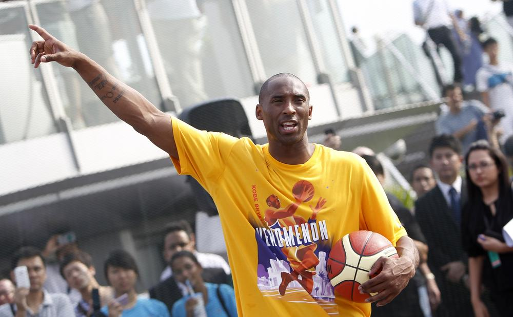 Los Angeles Lakers superstar Kobe Bryant reacts during a basketball clinic last weekend in Singapore. Bryant is considering playing overseas as the NBA lockout continues. (AP)