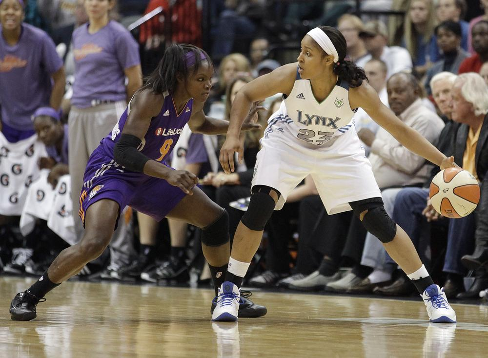 Minnesota Lynx forward Maya Moore protects the ball from Phoenix Mercury guard Marie Ferdinand-Harris during Game 1 of the Western Conference Finals on Thursday. (AP)
