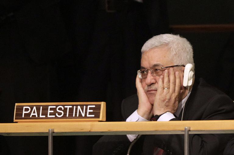 Palestinian President Mahmoud Abbas holds his hands to his face as U.S. President Barack Obama speaks during the 66th session of the General Assembly at United Nations headquarters Wednesday, Sept. 21, 2011. (AP)