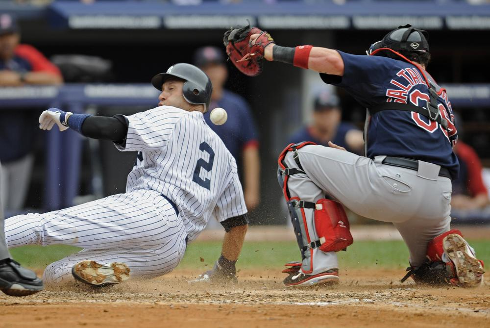New York Yankees runner Derek Jeter, left, scores on a single by Alex Rodriguez, Sunday. (AP)