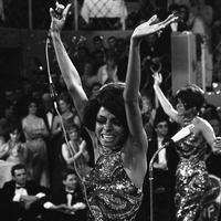 The Supremes with Diana Ross, front, Cindy Birdsong and Mary Wilson dance with their arms in the air as they perform in 1968. (AP/Frings)