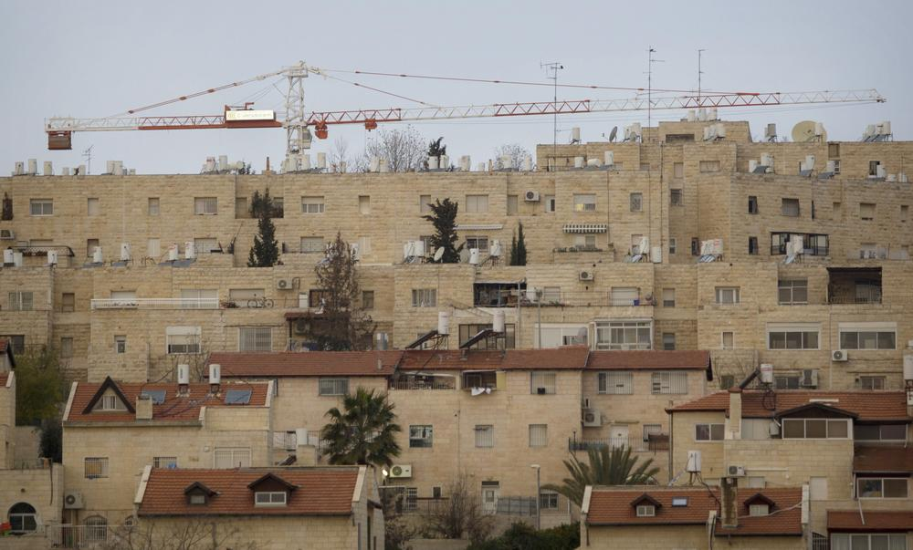 In this Jan. 16,  2011 file photo construction cranes are seen at the Jewish neighborhood of Gilo in Jerusalem.  Israel's government has given the final go-ahead for the construction of 1,100 new housing units in that area. (AP)