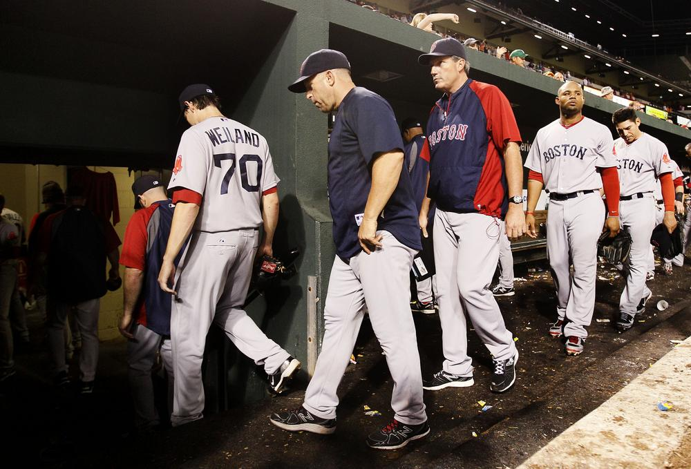 Members of the Boston Red Sox walk into the clubhouse after losing 6-3 to the Baltimore Orioles on Monday, Sept. 26, 2011, in Baltimore. (AP)