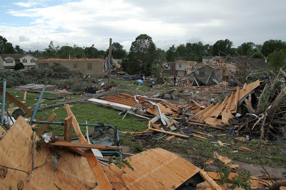 People pick through the debris in the wreckage of homes damaged by a tornado in Sedalia, Mo., in May, 2011. (AP)