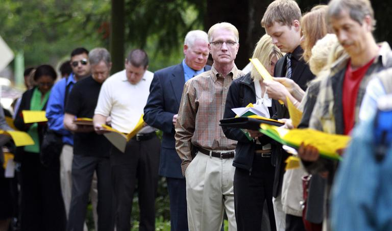 People wait in line at the 2011 Maximum Connections Job and Career Fair Thursday, Sept. 15, 2011, in Portland, Ore.  (AP)