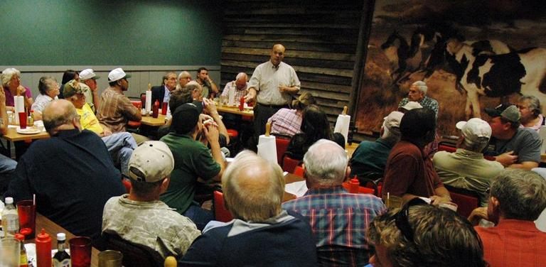 State Rep. Jeremy Oden addresses 50 farmers during a meeting about Alabama's new law against illegal immigration in Good Hope, Ala., earlier this month. (AP)