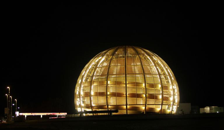In this Tuesday, March 30, 2010 file photo, the globe of the European Organization for Nuclear Research, CERN, is illuminated outside Geneva, Switzerland. Scientists at CERN, the world's largest physics lab, say they have clocked subatomic particles, called neutrinos, traveling faster than light, a feat that, if true, would break a fundamental pillar of science. (AP)