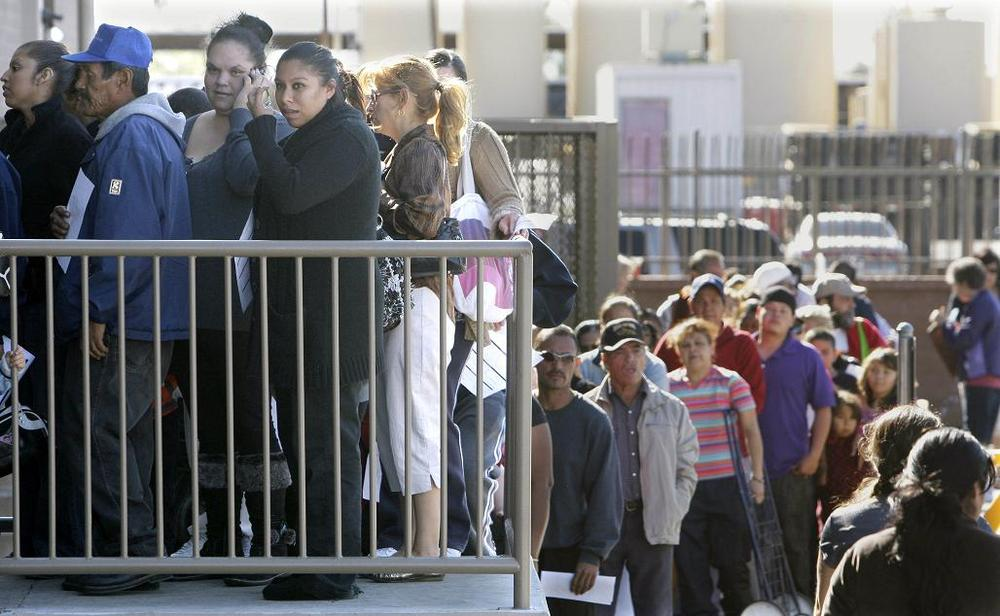 Hundreds lined up to pick up Thanksgiving dinners at the St. Mary's Food Bank Alliance in Nov. 2010, in Phoenix, AZ. (AP)