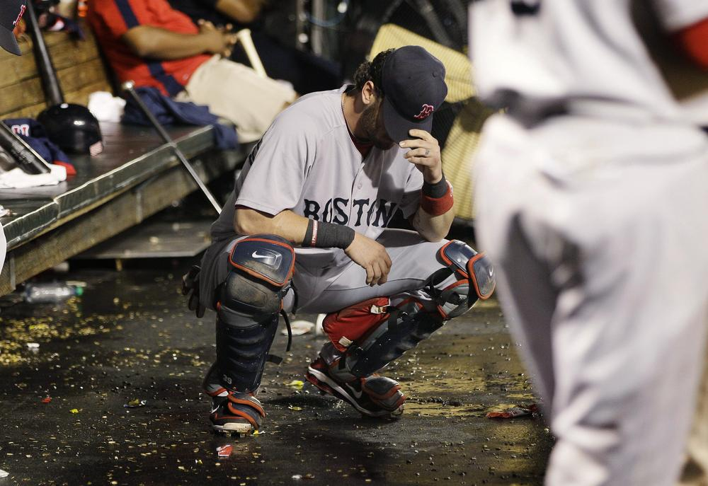 Red Sox catcher Jarrod Saltalamacchia reacts to Wednesday's loss to Baltimore. Boston was eliminated from the playoffs after the Rays beat the Yankees later that night. (AP)