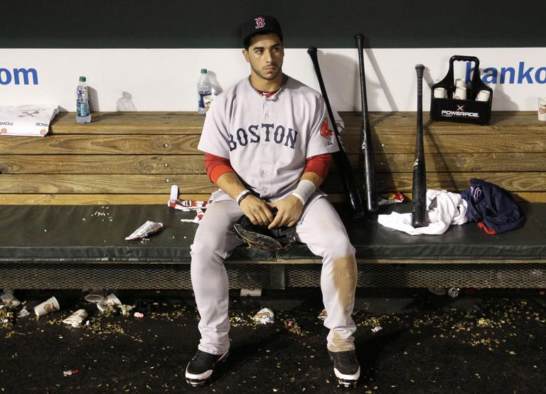 Boston's third baseman Mike Aviles sits in the dugout after Boston's loss to the Orioles, Wednesday. (AP)