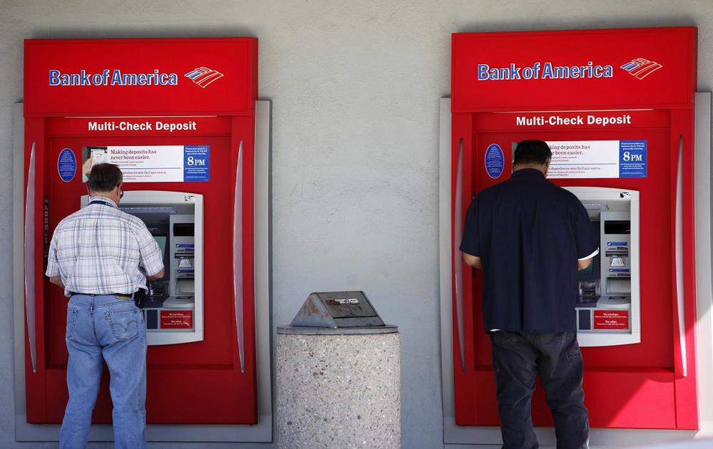Two customers use an ATM at a Bank of America bank in California. (AP)
