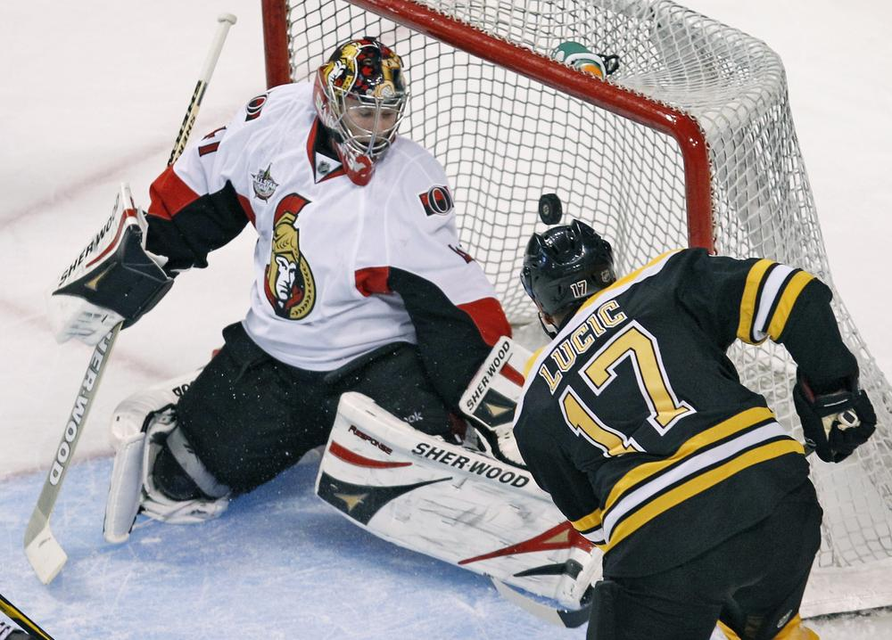 Boston's Milan Lucic,(17) beats Ottawa goalie Craig Anderson for a goal in the first period of the preseason game in Boston on Thursday. (AP)