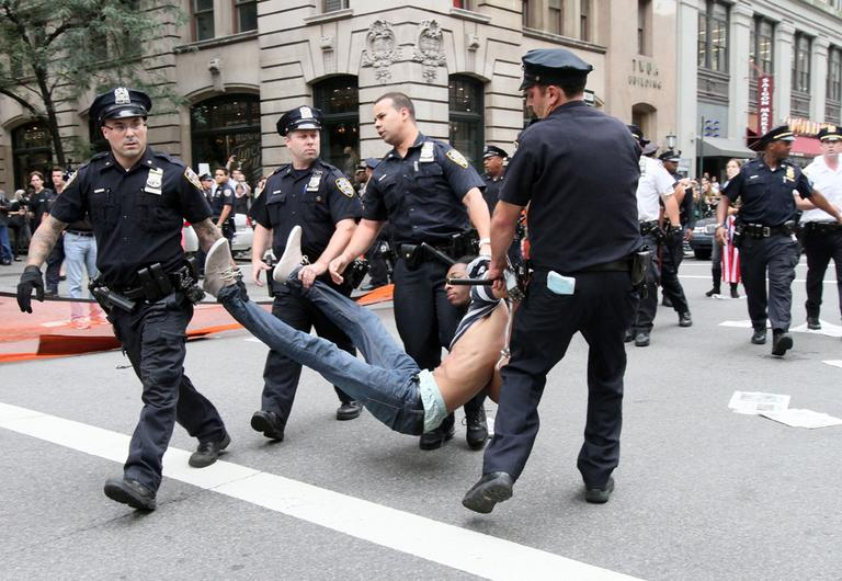 Police carry away a participant in a march organized by Occupy Wall Street in New York on Saturday Sept. 24, 2011. Marchers represented various political and economic causes. (AP)