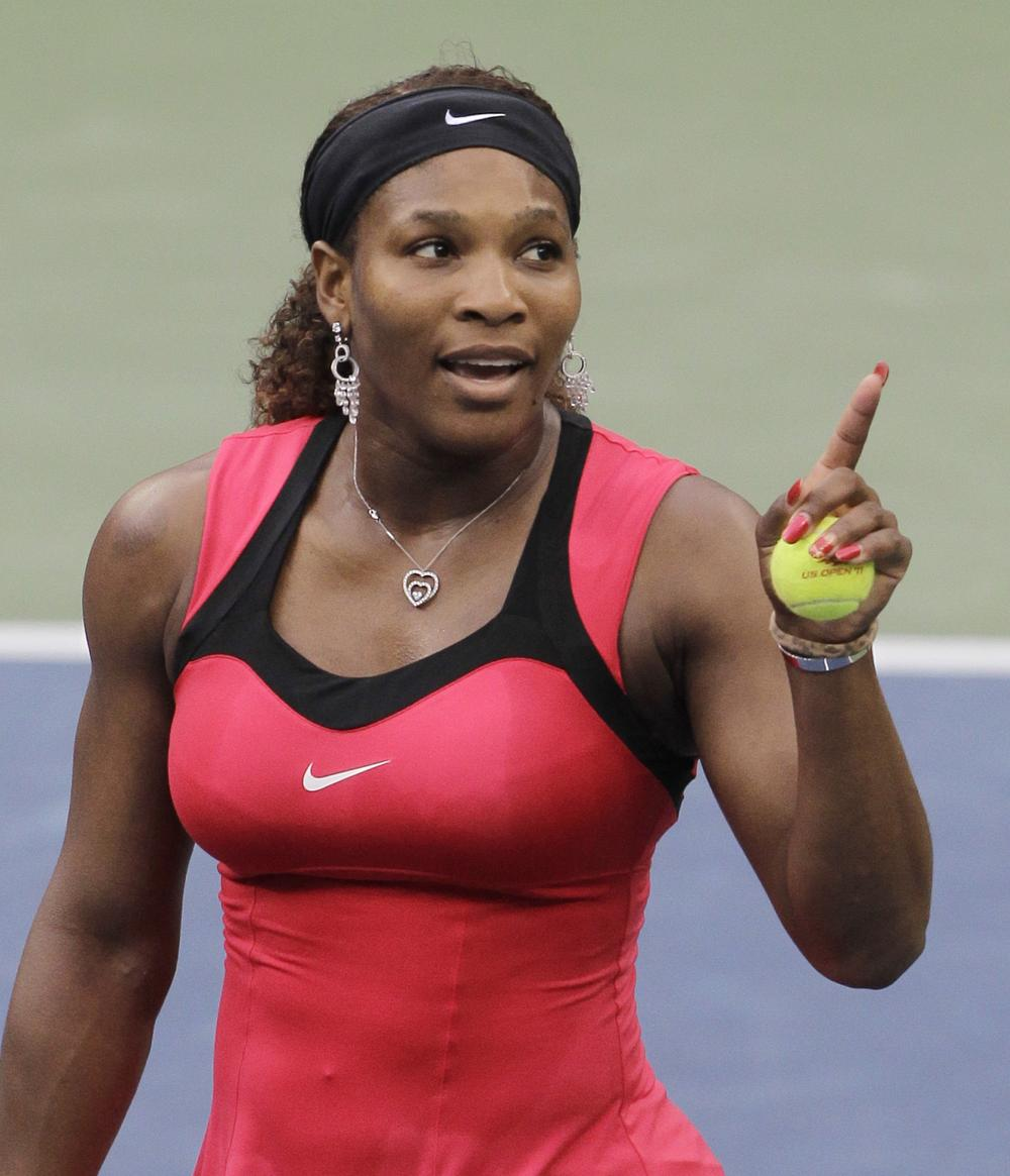 Serena Williams gestures while talking to chair umpire Eva Asderaki during the women's championship match at the U.S. Open tennis tournament in New York on Sunday. (AP)