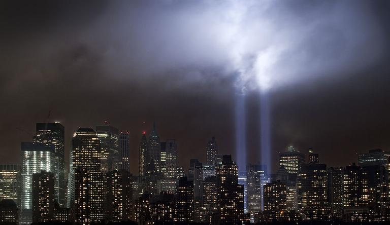 A test of the Tribute in Light rises above lower Manhattan, Tuesday, Sept. 6, 2011 in New York. Four World Trade Center, second from left, is under construction. The memorial, sponsored by the Municipal Art Society, will light the sky on the evening of Sept. 11, 2011 in honor of those who died ten years before in the terror attacks on the United States. (AP)