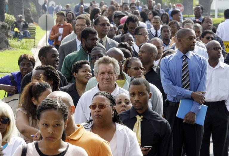 Crowds of job-seekers wait to enter a job fair at Crenshaw Christian Center in South Los Angeles, Wednesday, Aug. 31, 2011 (AP).