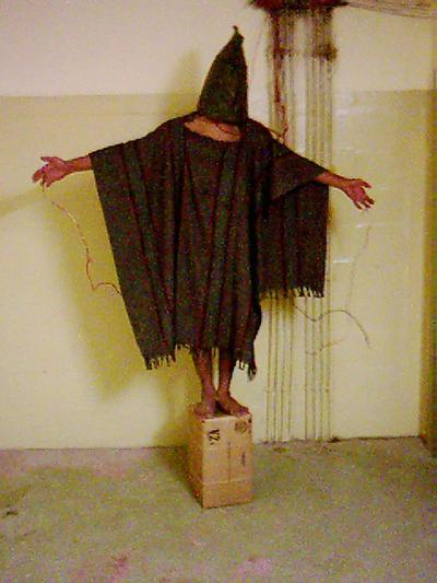 This picture of Ali Shalal Qaissi became symbolic of the torture at the Abu Ghraib prison west of Baghdad, Iraq. (Courtesy Penguin Press)