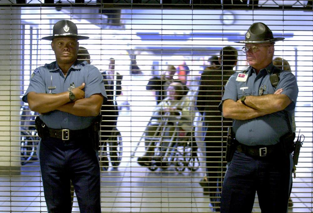 Massachusetts State Police troopers stand in front of the closed entrance to American Airlines gate area as passengers are evacuated at Logan International Airport in Boston on Sept. 11, 2001. A team of law enforcement officials quickly gathered at Logan that day to begin a criminal investigation. (AP)
