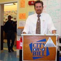 Patrick Foley in his classroom (Adam Ragusea/WBUR)