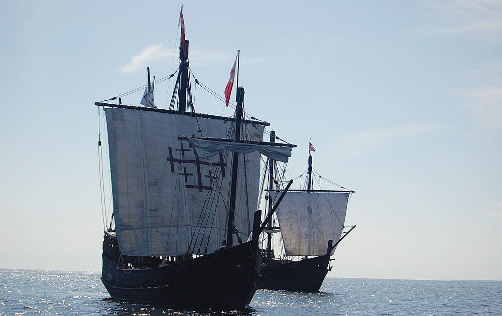 This 2009 photo shows replicas of the Nina, left, and Pinta, two of the ships in Christopher Columbus' fleet, on Lake Michigan near Green Bay, Wisc. (AP Photo/Columbus Foundation, Morgan Sanger)