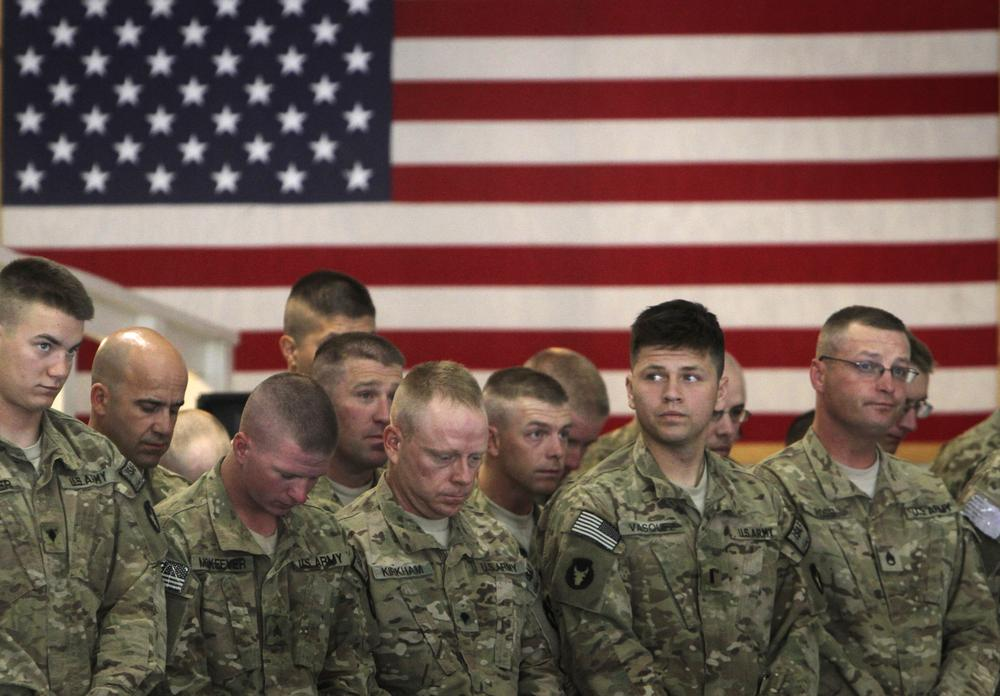 U.S. soldiers attend during a transfer of authority ceremony from Task Force Red Horse to Task Force Maverick at the U.S. base in Bagram, north of Kabul, Afghanistan in July. Task Force Red Horse is among two Cavalry regiments with the Iowa National Guard. (AP)
