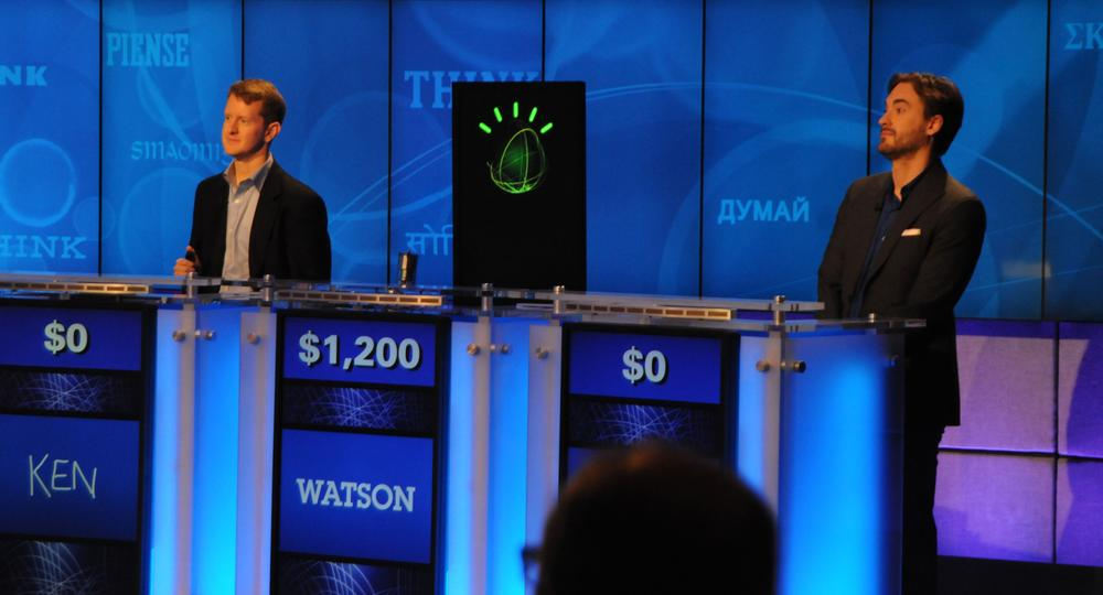 IBM's Watson computer system competes against Jeopardy! contestants Ken Jennings and Brad Rutter in a practice match held during a press conference at IBM's Watson Research Center in Yorktown Heights, NY. (Courtesy of IBM)