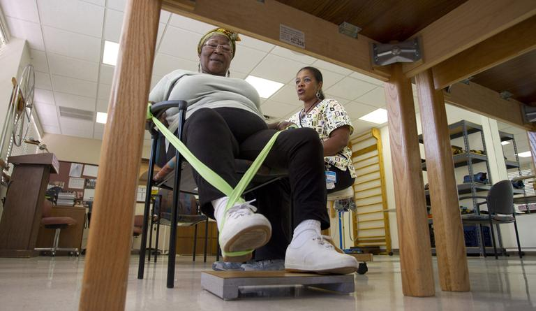 Elmaze Joseph, left, works with therapist Jocelyne Denis doing foot exercises at the Miami Jewish Home and Hospital in Miami. Across the U.S., facilities are widely expanding in-home care and assisted living, and looking to new ways to generate income beyond their traditional role of housing the elderly during the last years of their lives. (AP)