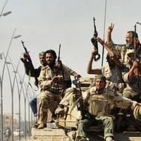Anti-Gaddafi fighters celebrate the fall of Sirte in the town. (AP)