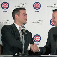 Former Boston Red Sox general manager Theo Epstein, left, shakes hands with Chicago Cub's owner Tom Ricketts, Tuesday. (AP)