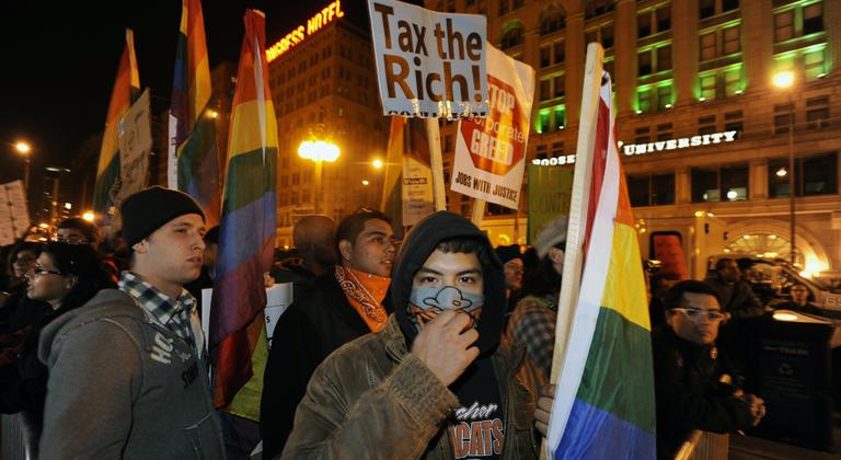 Protesters during an Occupy Chicago march and protest at Grant Park in Chicago, early Sunday, Oct. 23, 2011. (AP)