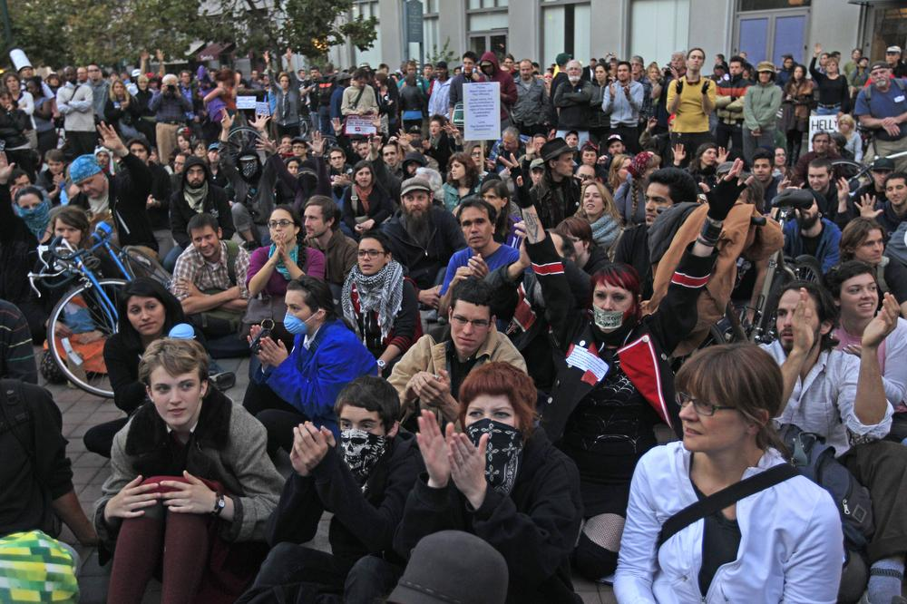 Protesters stage a sit in at Frank Ogawa Plaza, Wednesday, in Oakland, Calif. (AP)